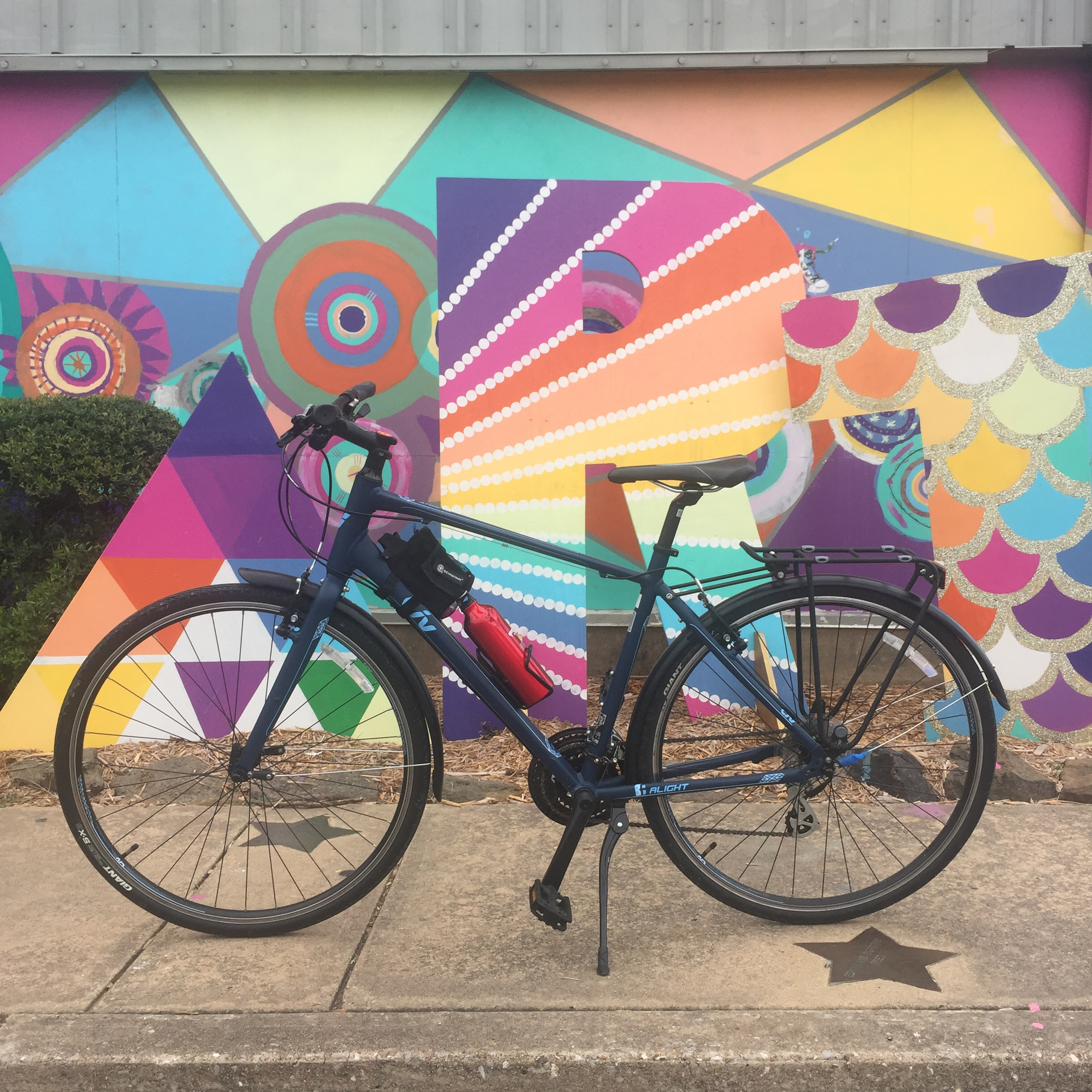 Image of bicycle in front of a public art piece at Arts Center of the Ozarks