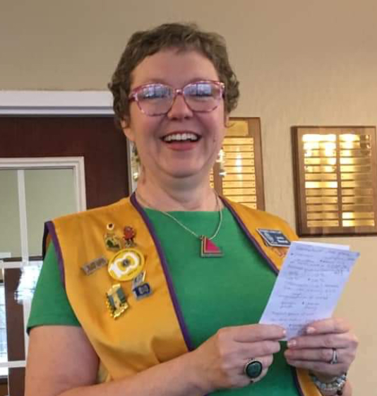 Image of a woman in a Lions Club vest